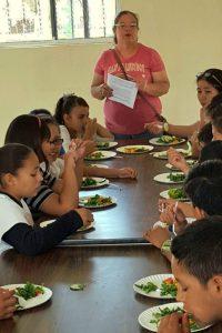students eat fresh salad