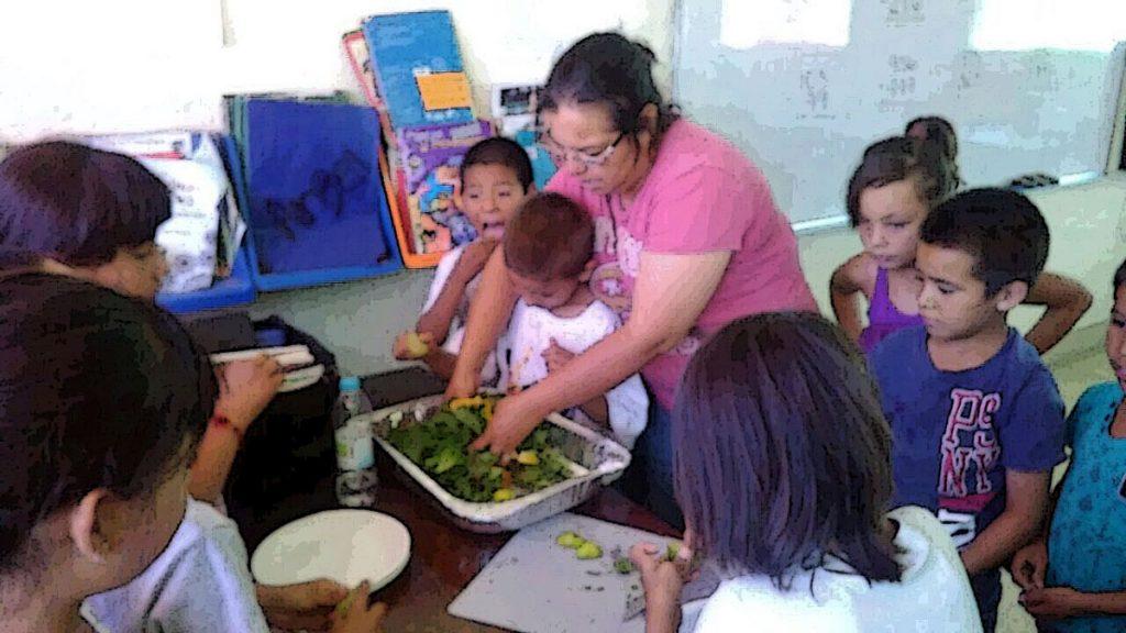 kids prepare fresh salad