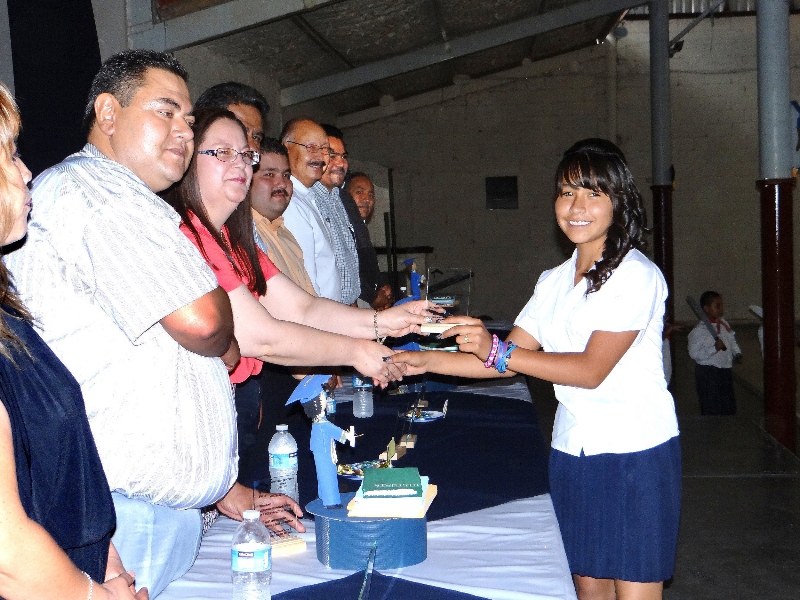 Proud graduate receives her certification from officials.