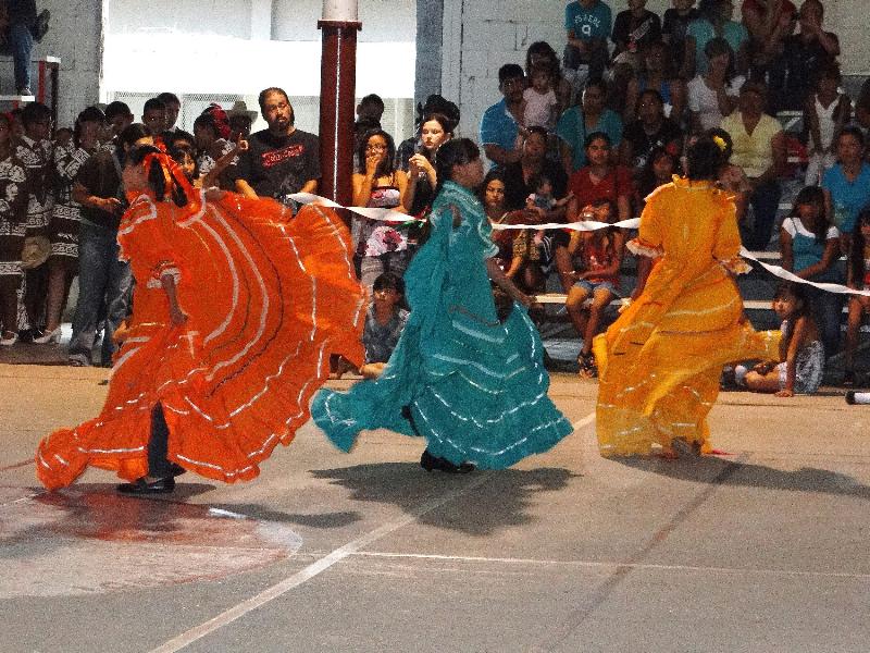 Colorful dance costumes brighten the hot desert landscape.