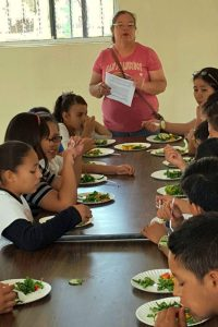 students eat fresh salad